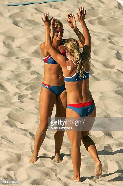 Kathrine Maaseide and Susanne Glesnes of Norway celebrate in the women's preliminary match on August 16 2004 during the Athens 2004 Summer Olympic...