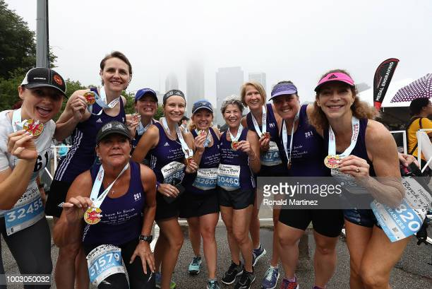 Kathrine Switzer and Team 261 Fearless pose with medals after competing in the 2018 Humana Rock 'n' Roll Chicago 5K at Grant Park on July 21 2018 in...