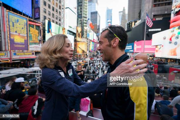 Kathrine Switzer who was the first woman to run the Boston marathon greets a friend in Times Square November 2 2017 in New York Switzer plans to run...