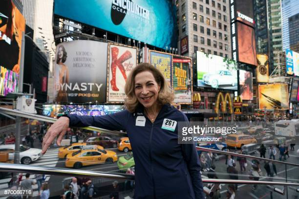 Kathrine Switzer who was the first woman to run the Boston marathon poses for a photo in Times Square November 2 2017 in New York Switzer plans to...