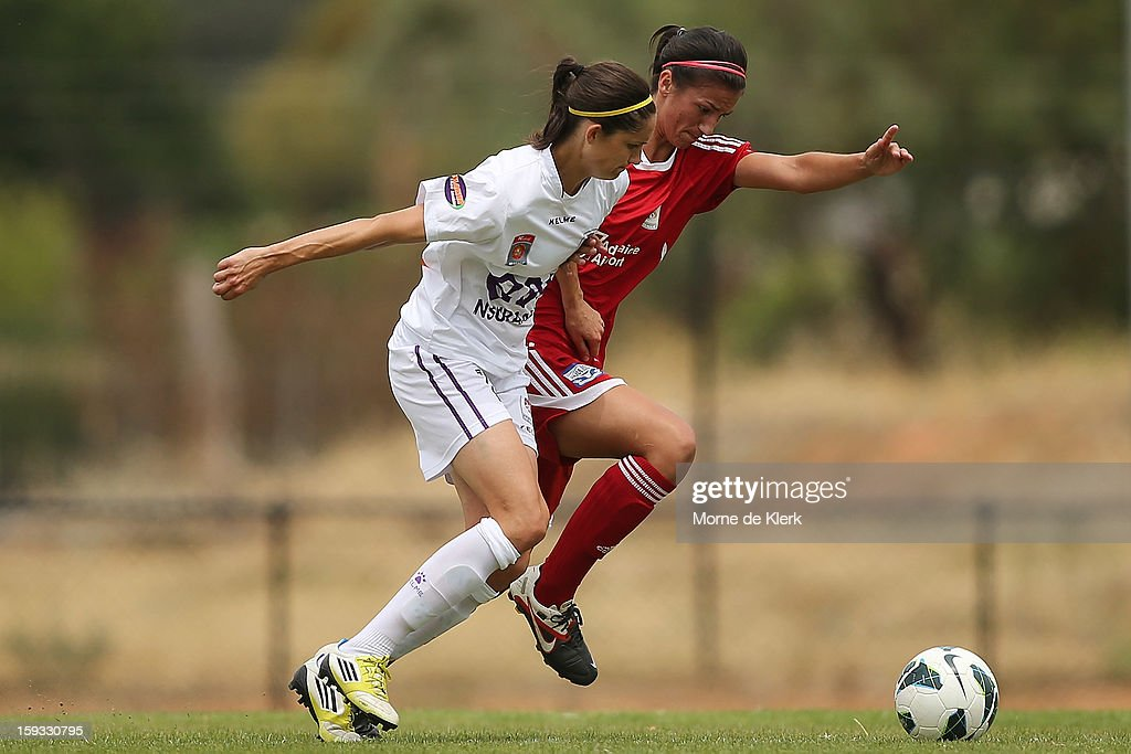 Kathry Gill of Perth competes with Abby Erceg of Adelaide during the round 12 W-League match between Adelaide United and the Perth Glory at Burton Park on January 12, 2013 in Adelaide, Australia.