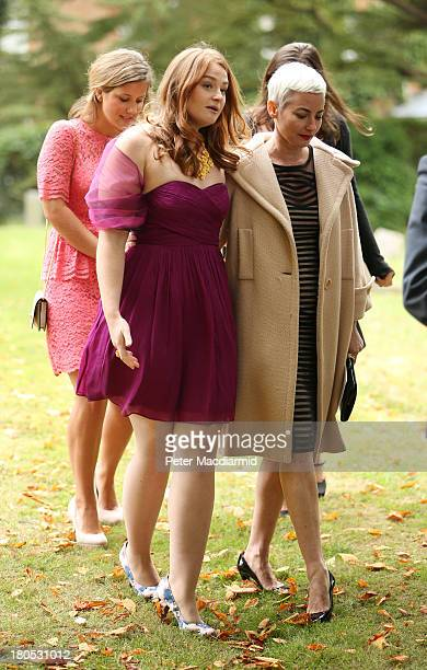 Kathryn Blair leaves All Saints Church after attending the wedding of her brother Euan Blair to Suzanne Ashman on September 14 2013 in Wotton...
