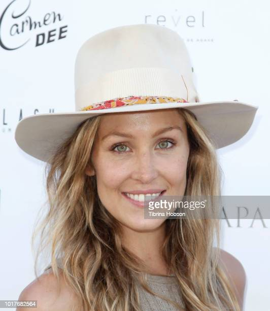 Julie Mintz and Derek Warburton attend LaPalme Magazine and Hiptique's Indian Summer Soiree at Trancas Country Market on August 15 2018 in Malibu...
