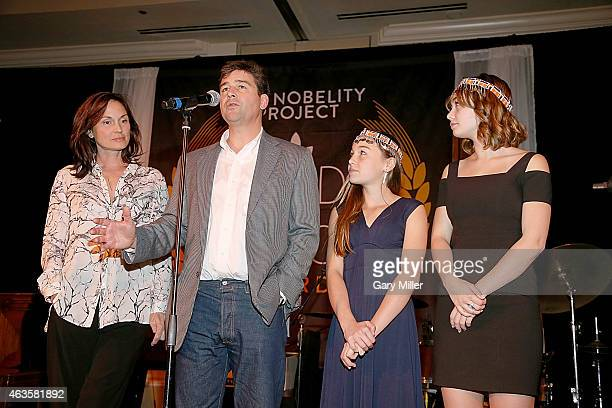 Kathryn Chandler, Kyle Chandler Sawyer Chandler and Sydney Chandler receive the Feed The Peace Award during the 10th Annual Nobelity Project Feed The...