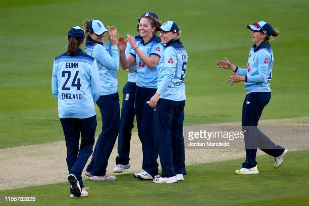 Kathryn Cross of England celebrates with her teammates after dismissing Kycia Knight of West Indies during the 3rd One Day International match...