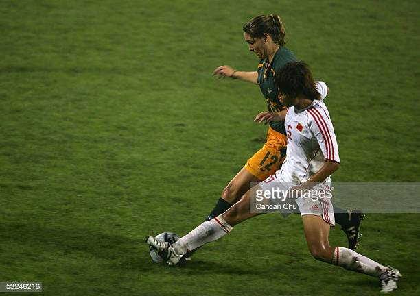 Kathryn Gill of Australia fights for the ball against Yuan Fan of China during a tour match between China and Australia on July 16 2005 in Tianjin...