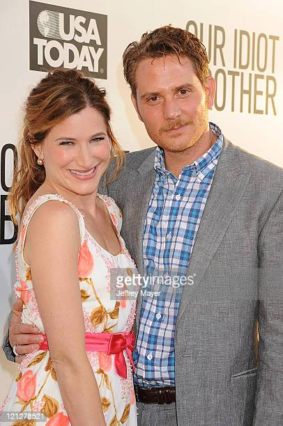 Kathryn Hahn and Brian Gattas attend the Los Angeles premiere of Our Idiot Brother at ArcLight Hollywood on August 16 2011 in Hollywood California