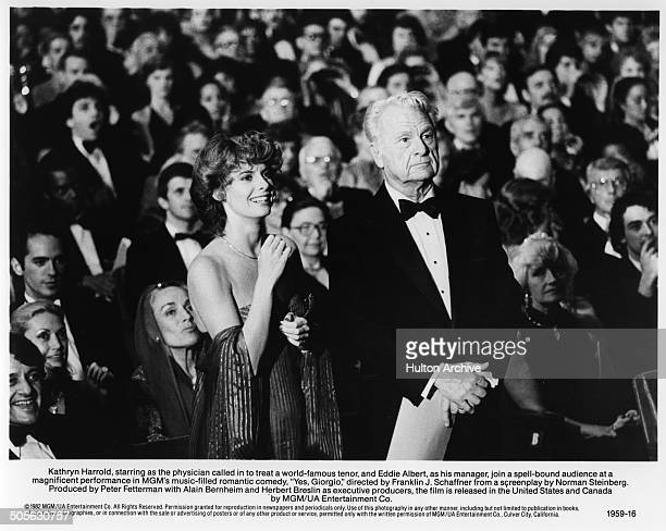 Kathryn Harrold and Eddie Albert stand in a scene from the movie Yes Giorgio circa 1982