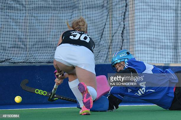 Kathryn Henry of New Zealandscores against Maria Belen Succi of Argentina during the international women's hockey test match between the New Zealand...