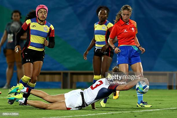 Kathryn Johnson of the United States dives to ground the ball to score a try during a Women's Pool A rugby match between the United States and...