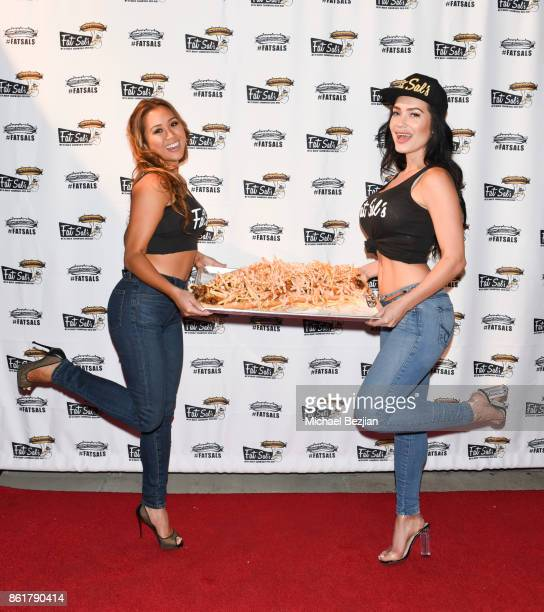 Kathryn Le and CJ Sparxx attends Fat Sal's Encino Grand Opening Party on October 15 2017 in Encino California