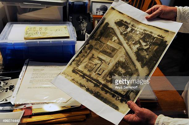 Kathryn Mann holds an aerial photo of the socalled Hanoi Hilton a POW camp used by the North Vietnamese during the Vietnam War in her home on...