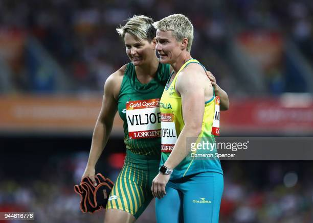Kathryn Mitchell of Australia is congratulated as she wins gold by bronze medalist Sunette Viljoen of South Africa in the Women's Javelin final...