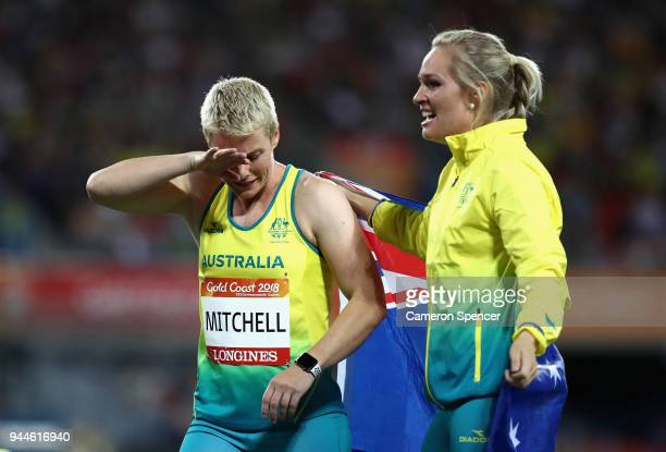 Kathryn Mitchell of Australia is congratulated as she wins gold by silver medalist KelseyLee Roberts of Australia in the Women's Javelin final during...