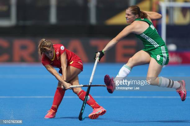 Kathryn Mullan of Ireland stops the pass from Maria Lopez of Spain during the SemiFinal game between Ireland and Spain of the FIH Womens Hockey World...