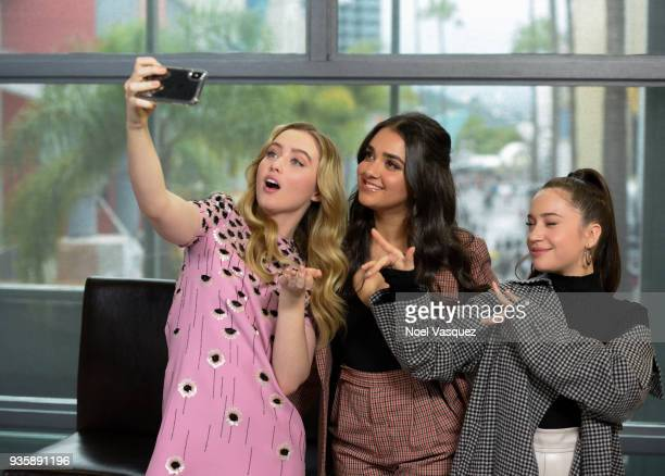 Kathryn Newton Geraldine Viswanathan and Gideon Adlon take a selfie together at Extra at Universal Studios Hollywood on March 21 2018 in Universal...