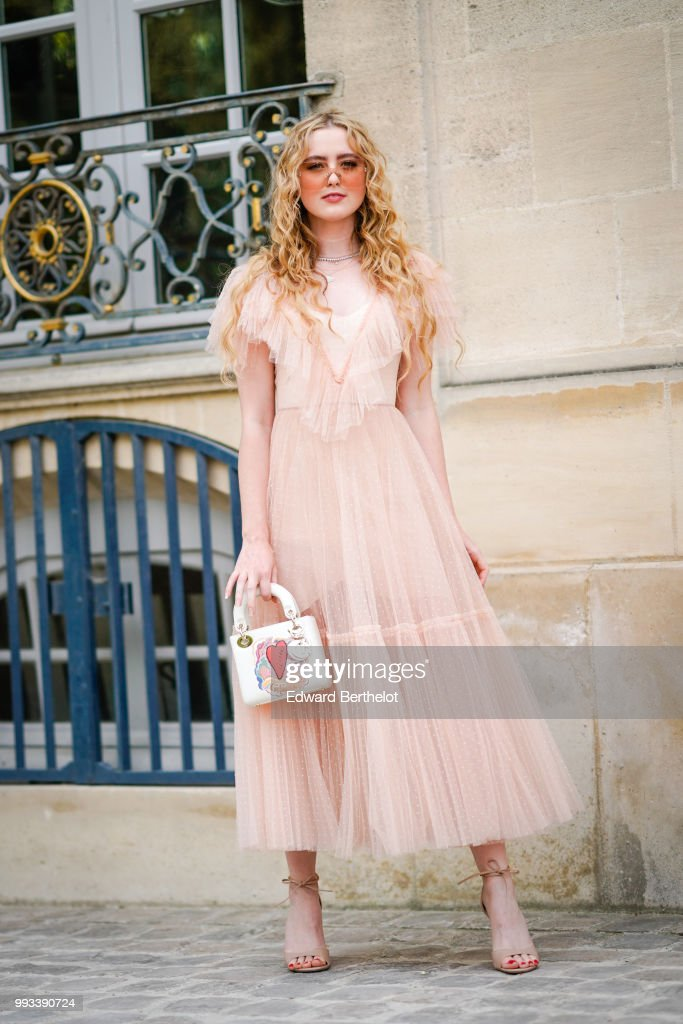Kathryn Newton Wears A Pink Lace Dress And Sunglasses