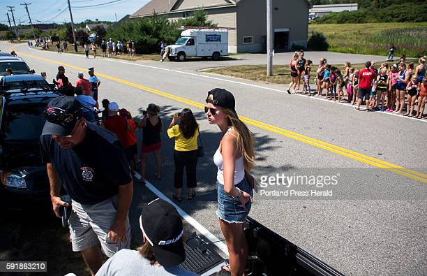 Kathryn Putnam of Paxton Mass waits in the bed of her Dad's truck for the chance to catch a glimpse of Brian Dumoulin and the 2016 Stanley Cup...