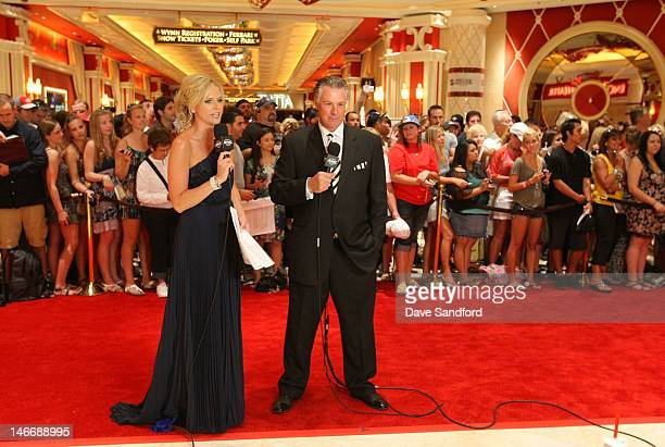 Kathryn Tappan and Barry Melrose of the NHL Network stand on the red carpet during arrivals before the 2012 NHL Awards at the Encore Theater at the...