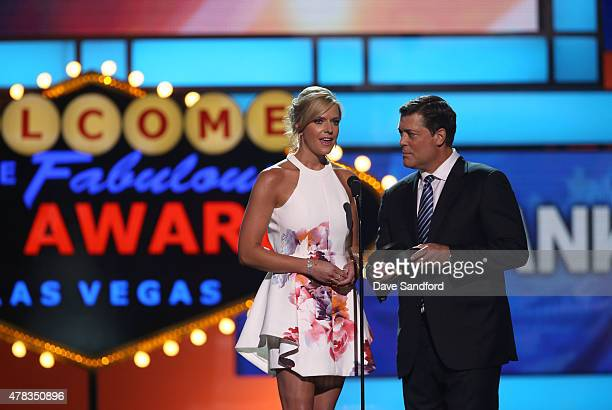 Kathryn Tappen and Pat LaFontaine speak onstage during the 2015 NHL Awards at MGM Grand Garden Arena on June 24 2015 in Las Vegas Nevada