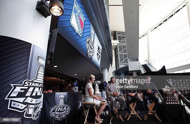 Kathryn Tappen Barry Melrose Mike Johnston and Martin Biron speak on set of the NHL Network during Media Day for the 2014 Stanley Cup Final at...