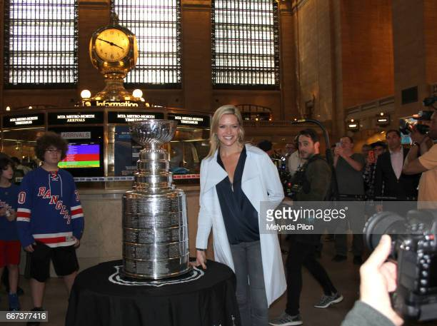 Kathryn Tappen poses with the Stanley Cup at Grand Central Station in New York City, New York.