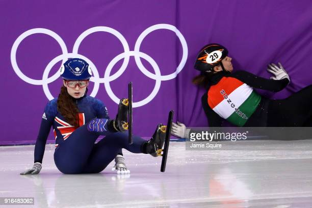 Kathryn Thomson of Great Britain and Andrea Keszler of Hungary crash during the Ladies' 500m Short Track Speed Skating qualifying on day one of the...