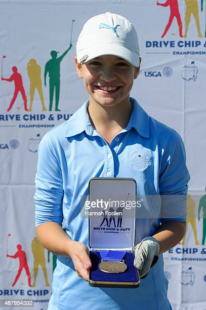 Kathryn Vanarragon poses for a photo after winning first place overall at a Regional Finals for 1011 year old girls at the Drive Chip and Putt...