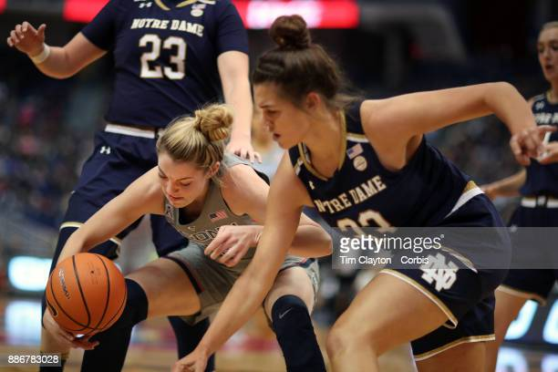 Kathryn Westbeld of the Notre Dame Fighting Irish and Katie Lou Samuelson of the Connecticut Huskies challenge for a rebound during the the UConn...