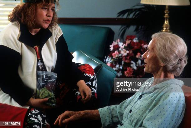Kathy Bates sitting on couch with Jessica Tandy in a scene from the film 'Fried Green Tomatoes' 1991