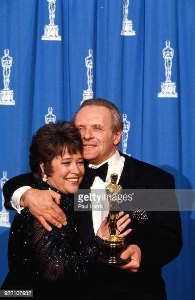 Kathy Bates Wins for Supporting Actress in a Miniseries at the 1991 Oscars and celebrates backstage with Anthony Hopkins March 25 1991