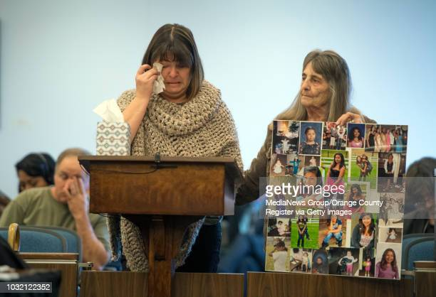 Kathy Branson mother of murder victim Kianna Jackson stands with Jackson's grandmother Diane Menzies as she delivers a victim impact statement during...