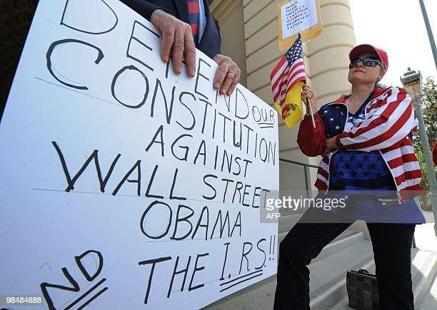 Kathy Bray attends a Tea Party rally to coincide with the tax filing deadline as they protest against high taxes and government spending outside the...