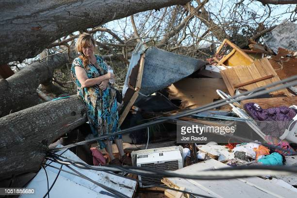 Kathy Coy stands among what is left of her home after Hurricane Michael destroyed it on October 11 2018 in Panama City Florida She said she was in...