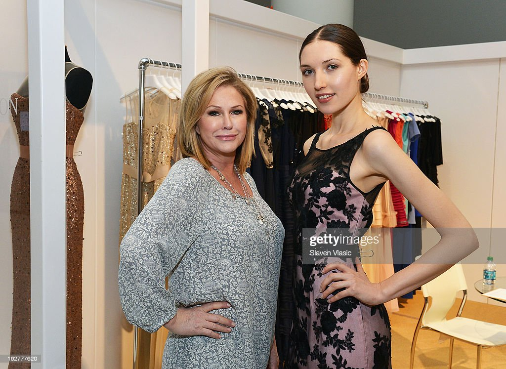 Kathy Hilton (L) and a model wearing her creation attend Kathy Hilton Fall 2013 Collection Preview at the Coterie International Fashion Exhibition at Jacob Javitz Center on February 26, 2013 in New York City.