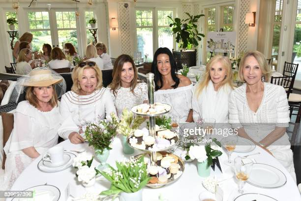 Kathy Hilton guest guest Kim Heirston Evans Jane Bunn and Luce Churchill attend Audrey Gruss All White Tea Hamptons Hope launch at a Private...