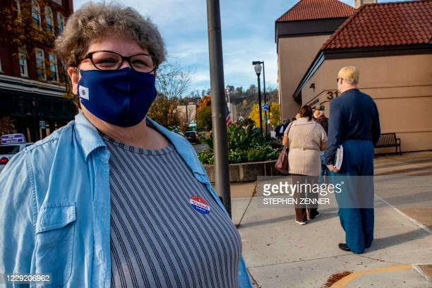 """Kathy Hunter displays her """"I Voted Today!"""" sticker after casting her vote at the Judge Black Annex polling station in Parkersburg, West Virginia, on..."""