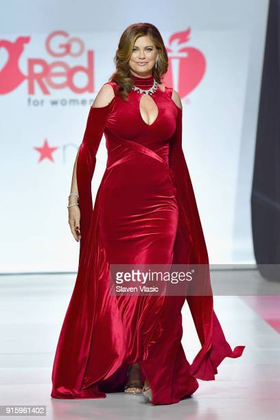 Kathy Ireland walks the runway during the American Heart Association's Go Red For Women Red Dress Collection 2018 presented by Macy's at Hammerstein...