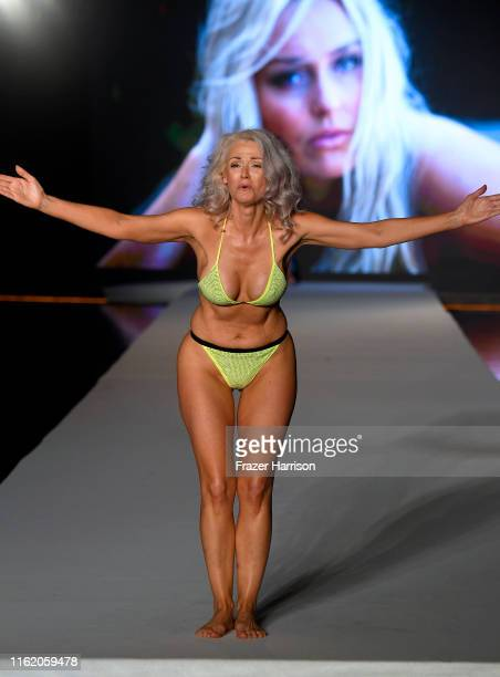 Kathy Jacobs walks the runway during the 2019 Sports Illustrated Swimsuit Runway Show During Miami Swim Week At W South Beach Runway at WET poolside...