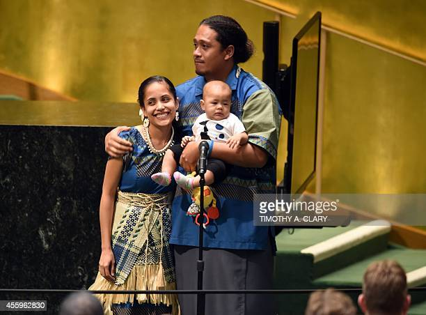 Kathy JetnilKijiner Civil Society Representative from the Marshall Islands shown with her husband and child during the Opening Session of the Climate...