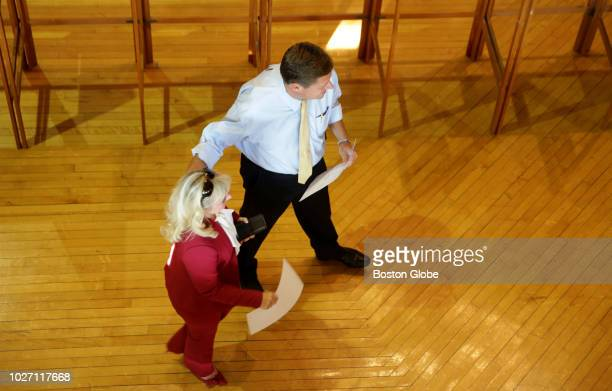 Kathy Jo Diehl left walks with her husband Geoff Diehl as they carry their ballots in the primary election at the Whitman Town Hall in Whitman MA on...