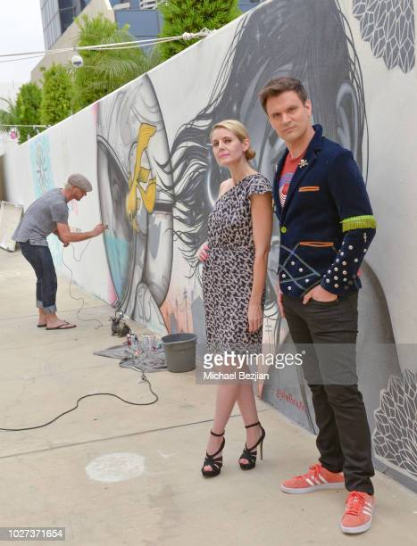 Kathy Kolla and Kash Hovey pose with #YesOn3 at Hans Haveron Donates Reve Sauvage To Environmental Groups At TAP The Artists Project on September 5...