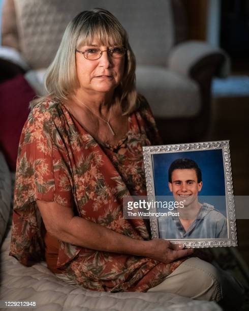 Kathy Lively, from Iaeger, West Virginia, holds a portrait of her son, Jason Lively, at her boyfriend's home in Lewisburg, West Virginia, on Monday,...