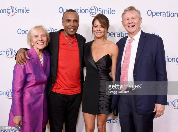 Kathy Magee, Sugar Ray Leonard, Brooke Burke, and Bill Magee arrive at Operation Smile's Hollywood Fight Night at The Beverly Hilton Hotel on...