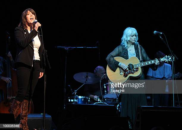 Kathy Mattea and Emmylou Harris performs during the Music Saves Mountains benefit concert at the Ryman Auditorium on May 19 2010 in Nashville...