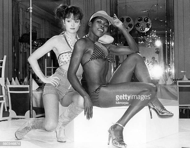 Kathy modelling a beach outfit in white and navy with drawstring waist and striped ticking shorts with Della Finch modelling a red and white striped...