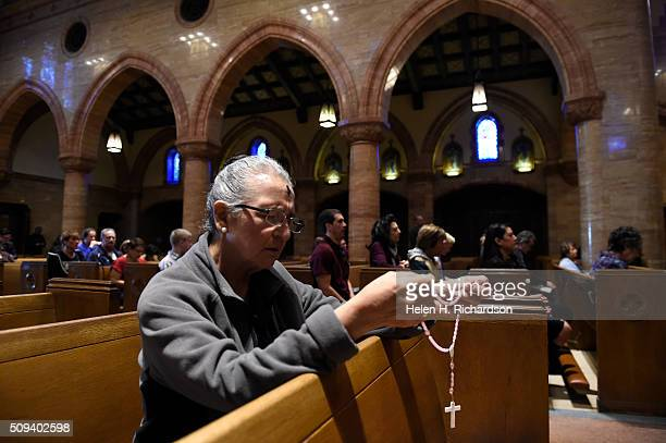 Kathy Montoya prays the rosary during Ash Wednesday mass at Holy Ghost Catholic Church on February 10 2016 in Denver Colorado