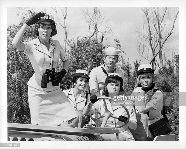 Kathy Nolan Lois Roberts Jimmy Boyd Sheila James and Joan Staley sitting in jeep in a scene from the film 'Broadside' 1964