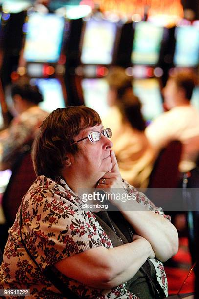 Kathy O'Donnell plays a slot machines at the Sands Casino Resort Bethlehem in Bethlehem Pennsylvania US on Friday May 22 2009 The casino which has...