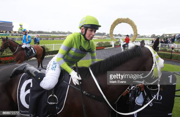 Kathy O'Hara on Black on Gold returns to scale after winning during Sydney Racing at Rosehill Gardens on November 4 2017 in Sydney Australia